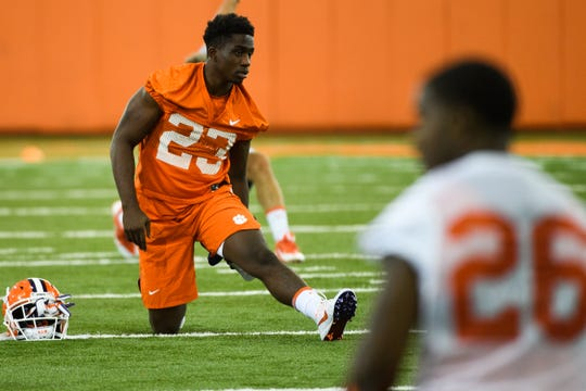 Clemson running back Lyn-J Dixon (23) stretches during practice at the Allen N. Reeves Football Complex Friday, Aug. 2, 2019.