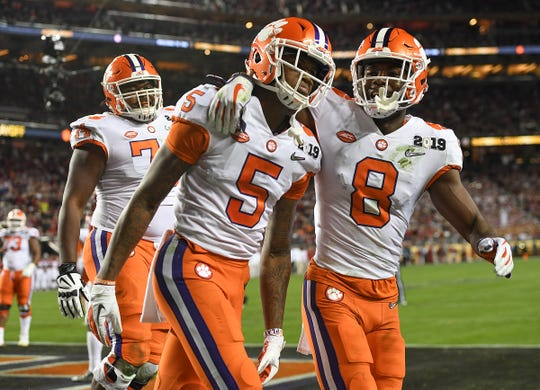 Clemson wide receivers Tee Higgins (5) and Justyn Ross (8) are threats to break the program's record for touchdown receptions in a game