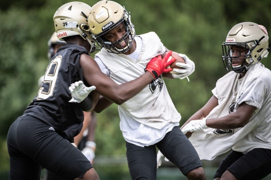 The Greer High School football team runs through drills during the first day of practice Friday, August 2, 2019.