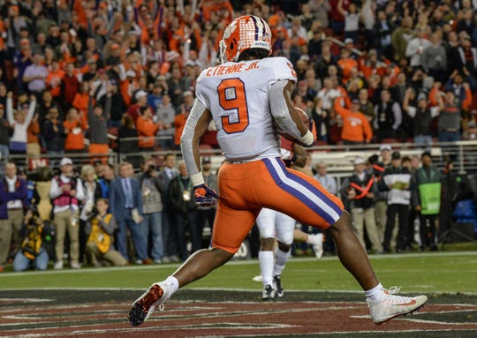 Clemson running back Travis Etienne (9) needs 11 rushing touchdowns in 2019 to become the Tigers' all-time leader.