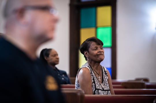 Vanessa Eastrich, 57, of Anderson, listens to speakers at a prayer service at Royal Baptist Church, Thursday, August 1, 2019, which Rev. Emanuel Flemming Sr. organized to address the gun violence the city has been struggling with.