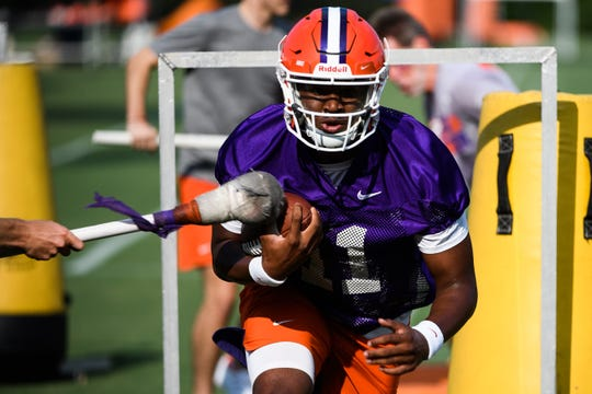 Clemson quarterback Taisun Phommachanh(11) runs through drills during practice at the Allen N. Reeves Football Complex Friday, Aug. 2, 2019.