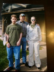 The family of Dusty Rollins includes his son Cody, left, and daughter Katie.