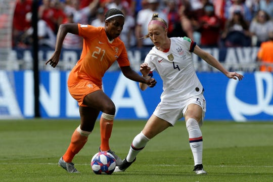 Becky Sauerbrunn, right, defends against The Netherlands' Lineth Beerensteyn during the United States' 2-0 victory in the World Cup final a month ago. Sauerbrunn's mother, Jane, is the 1969 valedictorian of Great Falls High.