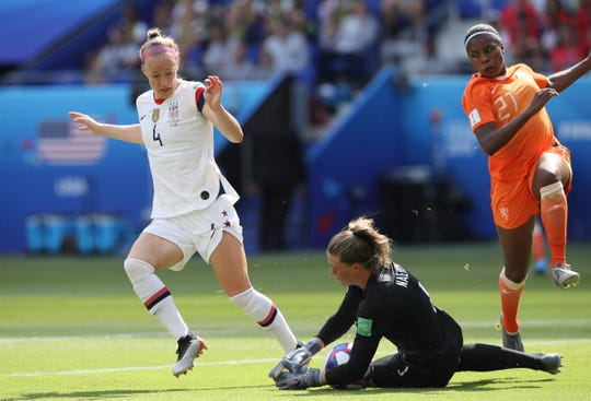 United States goalkeeper Alyssa Naeher makes a save in front of United States' Becky Sauerbrunn during the Women's World Cup final soccer match between U.S. and The Netherlands at the Stade de Lyon in France last month.