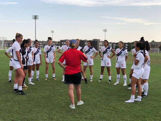 Lily Jose, No. 11, spends time with members of Guam's Women's National Team at a camp in Dallas in July 2018.