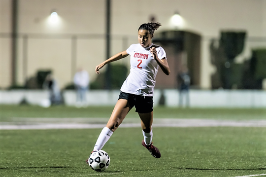 Lily Jose dribbles the ball in a high school match playing for Gunn High School in Palo Alto, California.
