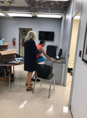 Mrs. Thompson helps a student register for classes (July 29, 2019).