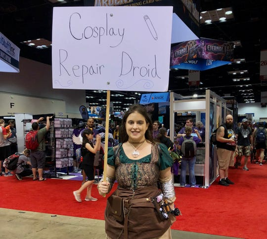 "Claire LaBarbera designated herself as a ""cosplay repair droid"" at this year's Gen Con. Clad with a hot glue gun and a sewing kit, she had already made four costume repairs by 11:30 a.m."