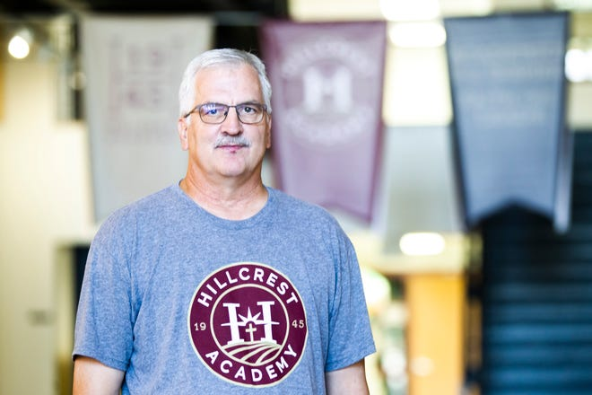 Dwight Gingerich, Hillcrest Academy principal and boys' basketball head coach, poses for a photo, Friday, Aug. 2, 2019, at Hillcrest Academy in Kalona, Iowa. Hillcrest was formerly known as the Iowa Mennonite School.