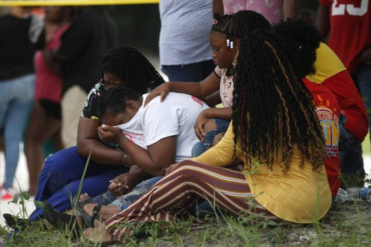 Families mourn as three teen's bodies are recovered from the Biloxi River after after drowning in Dedeaux Park. Officials said the boys were swimming before they went under, according to witnesses.