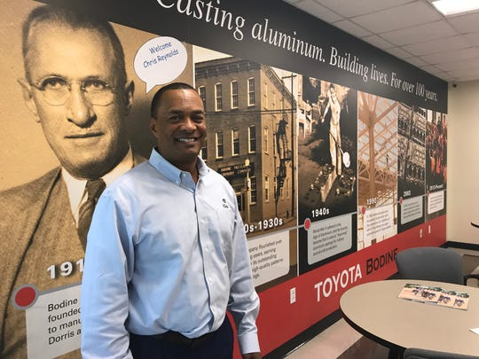 Toyota executive Chris Reynolds poses for a photo at the Bodine plant on Wednesday.