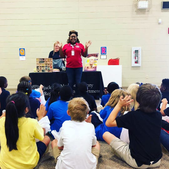In October 2018, Jackson-Madison County Regional Health Department health educator Akila McNeal talks about tobacco use with Denmark Elementary students.