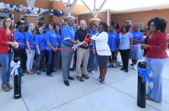 Jackson-Madison County Schools Superintendent Ray Washington, JMCSS Director of Maintenance Allen Powell and Lincoln Elementary School Principal Ladonna Braswell cut the ribbon during the grand opening of the new Lincoln Elementary School on Friday, Aug. 2. The building, which is partially inside the old Whitehall Pre-K, has been renovated with a new wing. Classes begin Aug. 5.