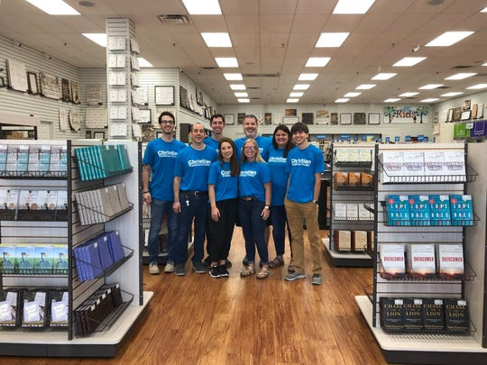 Much of the staff of the Christian Publishers Outlet during the store's first day of business earlier in July.