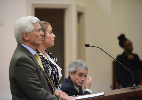 Jessica Conger, center, appears in court alongside her lawyer William Massey, front, in Jackson City Court on Aug. 2. Conger was cited for shoplifting at the North Jackson Walmart on July 21.