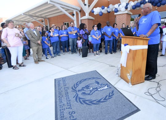 Fifth grade math teacher Steve Webster gives remarks during the grand opening of the new Lincoln Elementary School on  Friday, Aug. 2. The building, which is partially inside the old Whitehall Pre-K, has been renovated with a new wing. Classes begin Aug. 5.