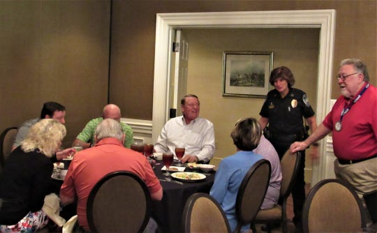 Making the rounds at the Farragut Rotary lunch meeting on July 31, Chief Eve Thomas speaks with regulars who always sit by the door in order to leave early. This time they stayed for the entire program.
