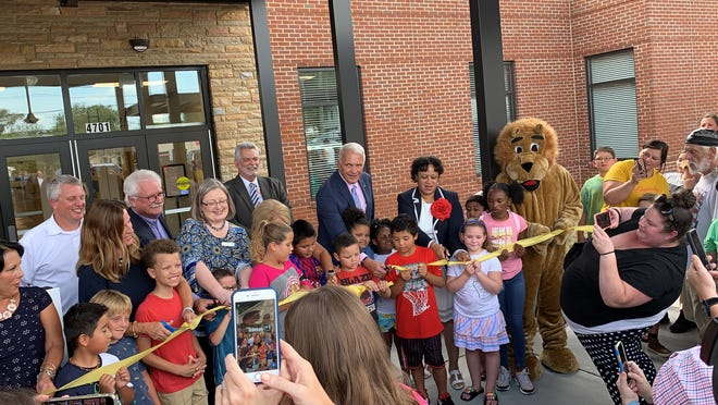 Superintendent Bob Thomas stands with Inskip Elementary students to celebrate the school's $6.5 million renovation Aug. 1, 2019.