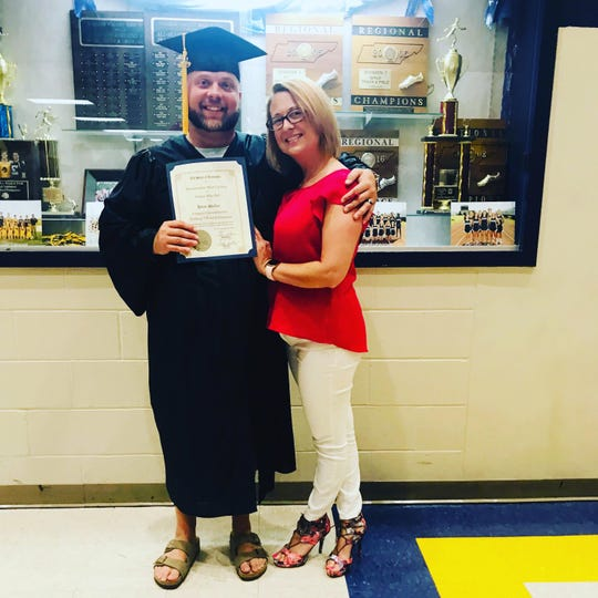 Brent and Ashley Walker standing together after Brent participated in GED graduation ceremony on June 20, 2019. Brent had earned passed his GED test the previous year.
