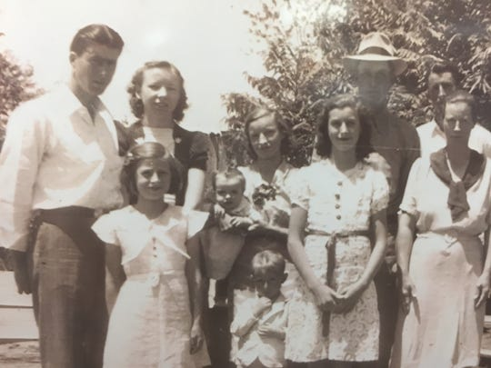 Delbert Gilbert with his wife, brothers, sisters and parents in West Tennessee circa 1940.