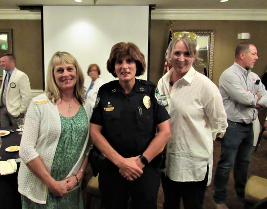 Chief Eve Thomas is greeted by FWKCC office and events manager Susan Roberts and president Julie Blaylock at the Rotary lunch on July 31.