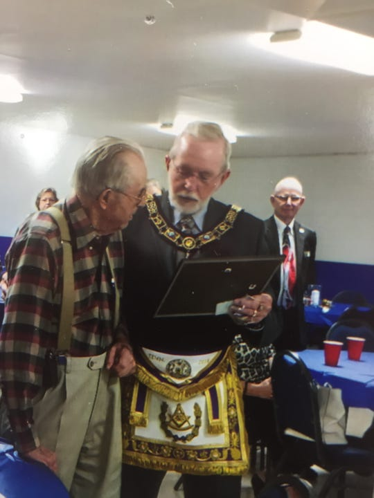 Delbert Gilbert, left, receives an award for his 70 years as a Mason from the Grand Master from Nashville at the Masonic Lodge, November 2018.