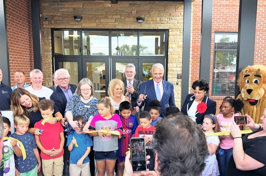 Inskip Elementary principal Lynn Jacomen, board of education representative Jennifer Owen and Knox County Schools Superintendent Bob Thomas have students assist in the ribbon cutting ceremony at Inskip Elementary on Aug. 1, 2019. Afterward, families toured the expansion project and enjoyed the back-to-school bash.