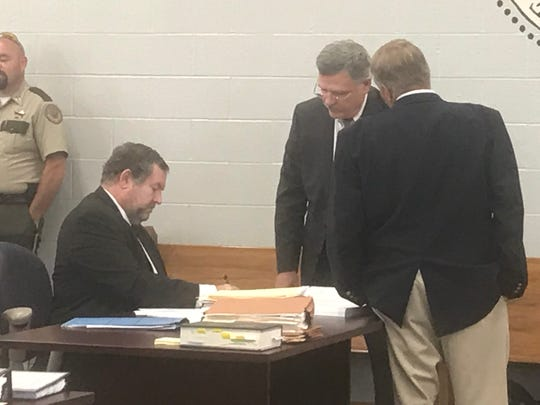Prosecutors Dave McGovern, left, and Steve Strain discuss terms of a plea deal offered to Adam Braseel on Friday.