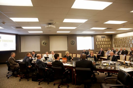Trustees discuss the agenda during a Purdue board of trustees meeting, Friday, Aug. 2, 2019 at Stewart Hall in West Lafayette.