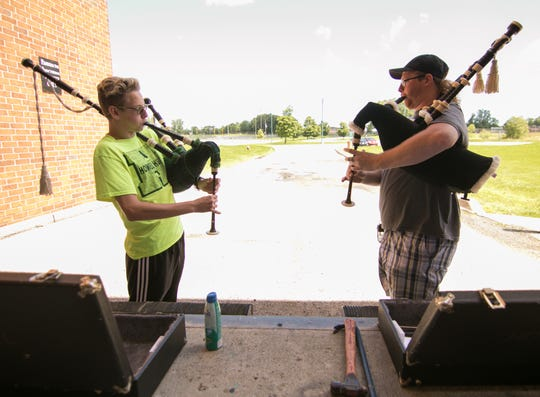 Brent Nichols at left, going into his sophomore year at Howell High School, plays 'Scotland the Brave' with his teacher Jake Spangler, a 2013 Howell High School graduate at the school's loading dock Friday, June 21, 2019.