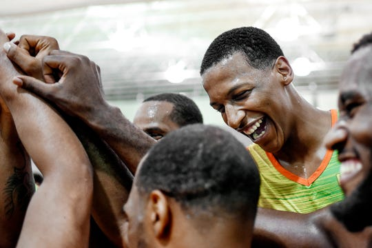 Michigan State's Marcus Bingham Jr. and the rest of Team Citron celebrate after winning the Moneyball Pro-Am championship game on Thursday, Aug. 1, 2019, at Aim High Sports in Dimondale. Team Citron beat Team Roots 82-78.