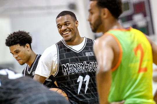 Michigan State's Xavier Tillman smiles before going to the line after being fouled during the first half of the Moneyball Pro-Am championship game on Thursday, Aug. 1, 2019, at Aim High Sports in Dimondale.