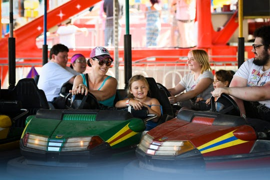 Katie Wright and daughter Leighton, 6, of Leslie, middle, drive bumper cars Thursday, Aug. 1, 2019, at the 165th Ingham County Fair in Mason. Ingham, Eaton and Clinton county fair boards are wrestling with how they will ensure safety at their fairs this summer during the COVID-19 pandemic.