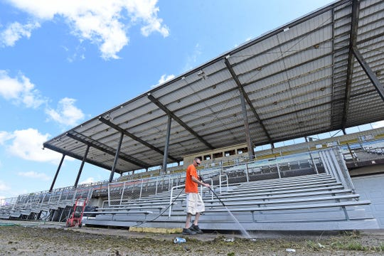 Steve Hummel power washes the grandstand area at the Richland County Fairgrounds on Friday. The fair runs Sunday through Aug. 10.