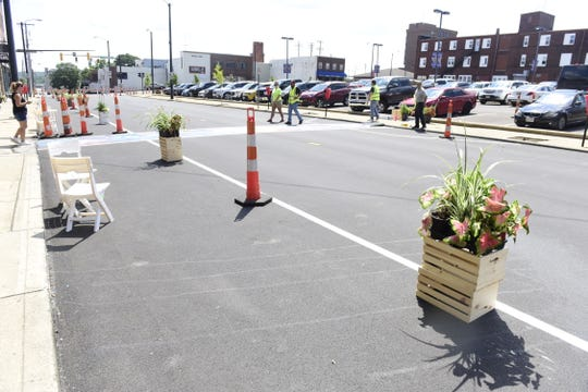 The display will run now to Aug. 18, and shows residents what it would look like if the sidewalk was expanded on the north side of East Fourth Street.