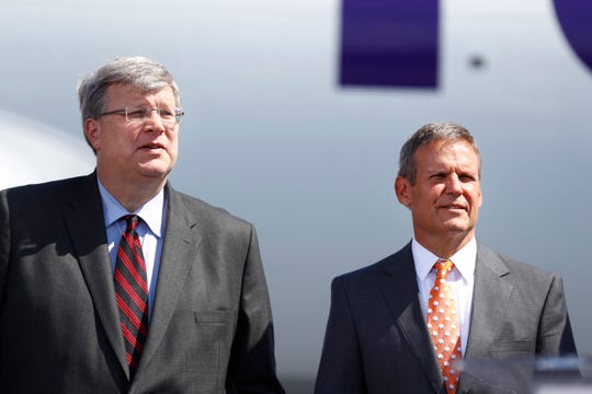 Memphis Mayor Jim Strickland, a Democrat who is seeking a second term in this year's nonpartisan city elections, has been criticized for reaching across the aisle. He's shown here at an economic development announcement with Republican Gov. Bill Lee.