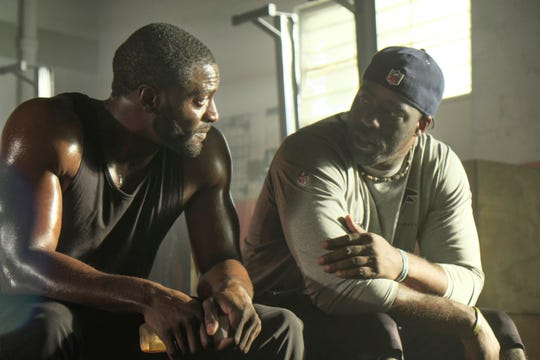 "Aldis Hodge and Brian Banks on the set of Tom Shadyac's ""Brian Banks."""