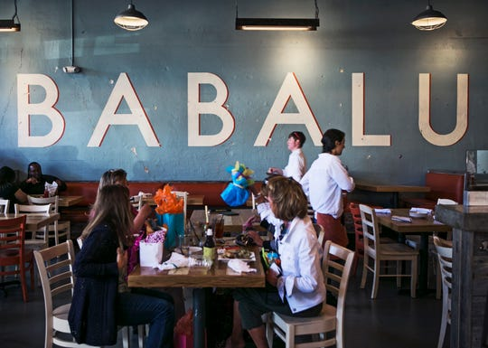 October 18, 2014 - Customers dine inside Babalu Tacos & Tapas, at 2115 Madison Ave., in Overton Square.