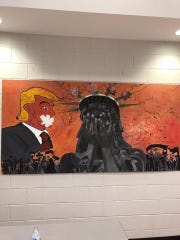 This piece of student artwork at Southwind High School outside Memphis, Tenn., was removed after the school received a threat. The art had garnered media attention earlier that day after criticism from supporters of President Donald Trump.