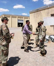 U.S. Rep. David Kustoff meets service members at Fort Bliss during the week of July 31, 2019 in this photo released by his staff.