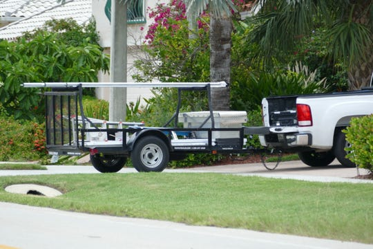 A utility trailer obstructs the sidewalk at N Barfield Dr. on July 31, 2019.