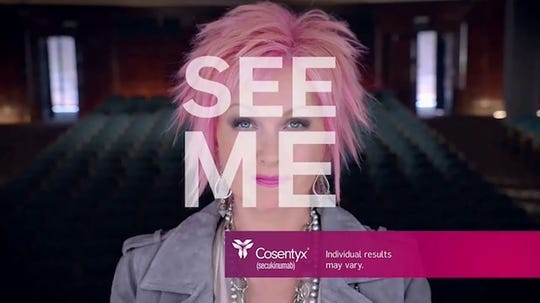 This screen grab shows pop entertainer Cyndi Lauper, representing Cosentyx, in a commercial about the psoriasis medication.