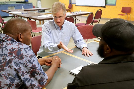 Bill Harrigan (center) talks with Johnnie Rose, left, and Elijah Tucker-Carter at the New Beginnings Are Possible Youth Center, 6100 N. 42nd St., Milwaukee. Harrigan's company is called Harrigan Solutions, and most of the people he hires are ex-offenders coming out of prison. With his help, some go on to other jobs they've dreamed of.