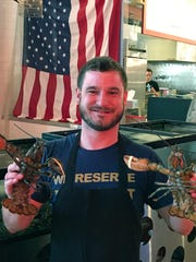 JP Toske of St. Paul Fish Company sells lobster in various sizes and types.