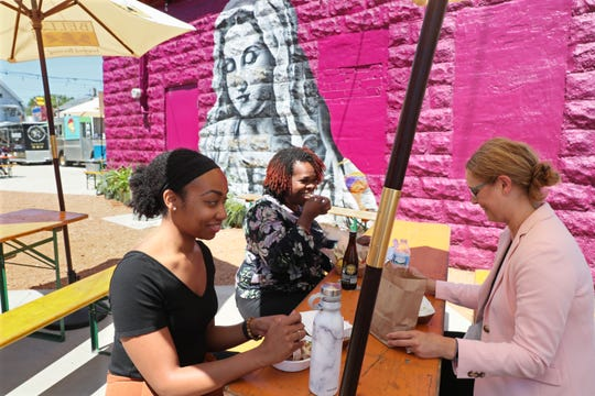 Kelly Wright (from left) of Oak Creek, Phyllis Clark of Wauwatosa, and Dana Miller of Whitefish Bay all co-workers at a nearby business, enjoy lunch together at Zocalo Park on Aug. 1, 2019.