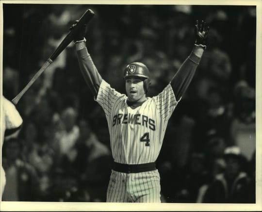 Paul Molitor signals to Mike Felder to come home standing up with the winning run in a memorable 1987 game. The Brewers won, 1-0, and Molitor's 39-game hitting streak came to an end.