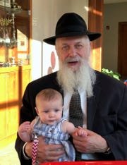 Rabbi Dovid Rapoport, director of Chabad of Mequon, relaxes with his great-granddaughter.