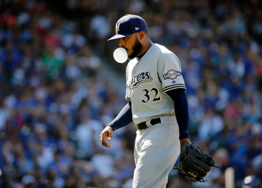 Brewers reliever Jeremy Jeffress is taken out of the game against during the sixth inning.