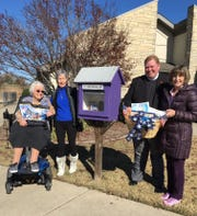 Members of the Captain Nathan Watkins Chapter of the Daughters of the American Revolution recently pledged $300 for the purchase of children's and young adult books to be given to the Little Free Library located at 511 Coley Drive. Pictured are: (from left) Carolyn McVicker;Sharon Ward;Father Kevin Gore ofSt. Andrews Episcopal Church; andSally Soderblom, DAR member.